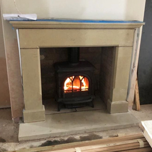 Bespoke Natural Stone Fireplace with Stovax Woodburner