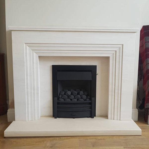 Kinder Oasis Plus gas fire in limestone fireplace suite Stockport