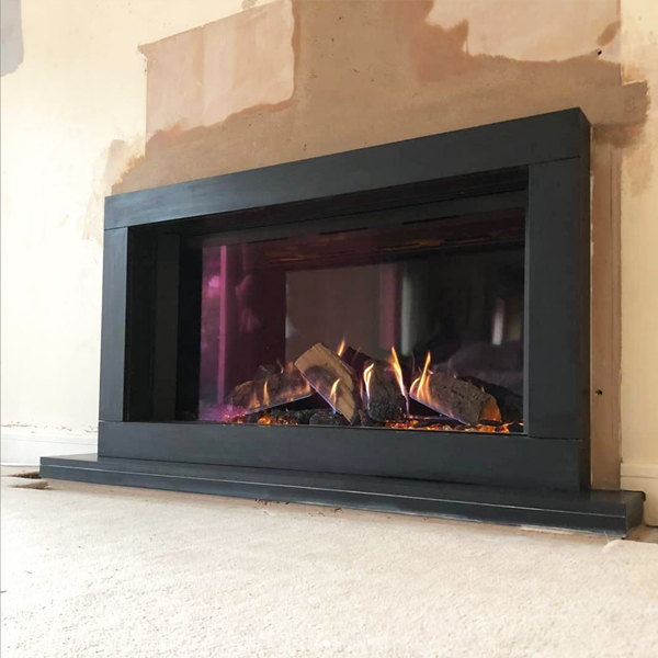 Sorrento black limestone surround with Gazco Reflex 105 gas fire
